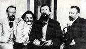 В.М. Васнецов рисует А.М. Горького по памяти. Рядом с ними А.И. Алексин и Л.В. Средин.